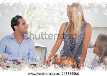 Happy wife bringing turkey to the table against fir tree forest and snowflakes - stock photo