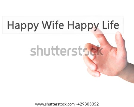 Happy Wife Happy Life - Hand pressing a button on blurred background concept . Business, technology, internet concept. Stock Photo