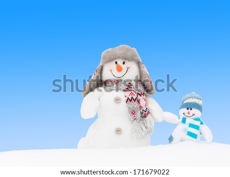 Happy winter snowmen family or friends background (copy space) - stock photo