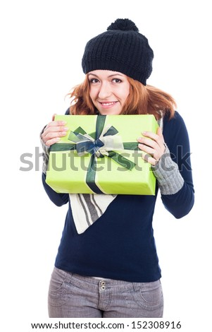 Happy winter woman holding present, isolated on white background. - stock photo