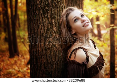 Happy wishful young woman day dreaming outdoor - stock photo