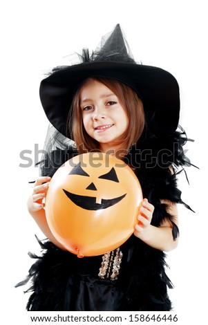 Happy witch woman holding pumpkin balloon.