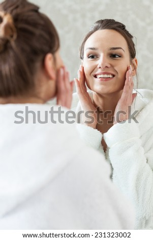 Happy woman after facial treatment in spa - stock photo
