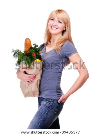 Happy woman after shopping in a grocery store studio shot