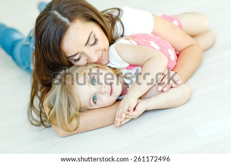 Happy woman and child - stock photo