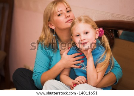 Happy woman and her daughter  having fun indoors