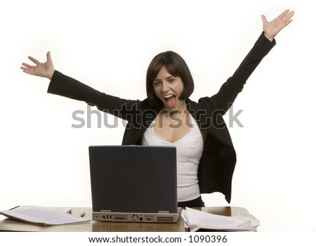 Happy woman at her desk - stock photo