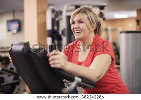 Happy woman at the gym  - stock photo