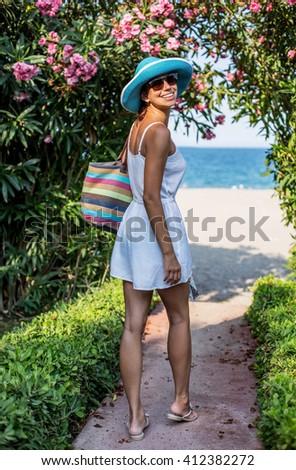 Happy woman at the sea resort.  - stock photo