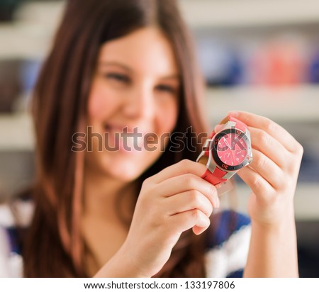 Happy Woman Buying New Wristwatch, Indoors - stock photo