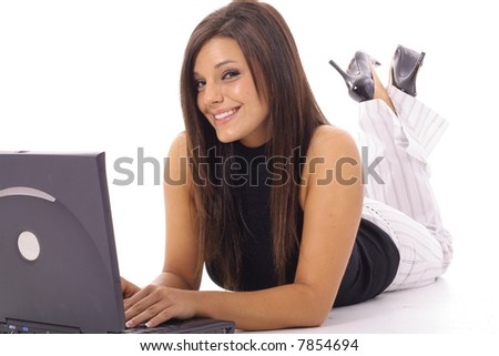 happy woman checking emails on laptop - stock photo