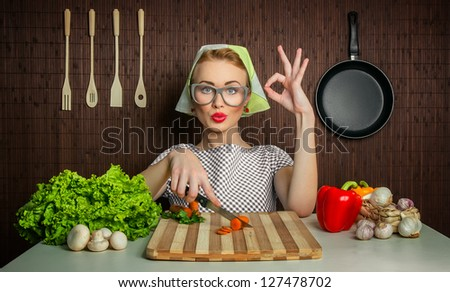 Happy woman cook with okay sign cut carrot-vintage concept - stock photo