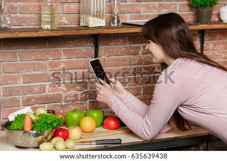 Happy Woman Cooking On Kitchen Woman Uses Stock Photo (Royalty Free ...