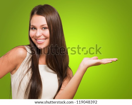 Happy Woman doing a gesture against a green background - stock photo