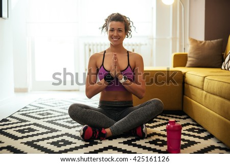 Happy woman doing yoga at home. - stock photo