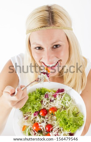 Happy woman eating fresh healthy food. - stock photo