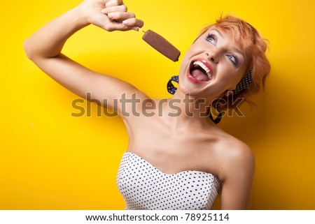 Happy woman eating ice cream - stock photo