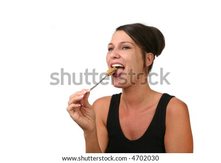 Happy Woman Eating Peanut Butter on a Spoon - stock photo