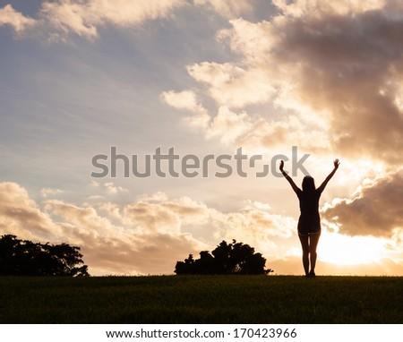 Happy woman enjoying sunset. Freedom concept. - stock photo