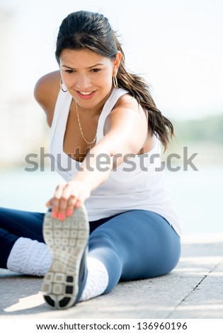 Happy woman exercising outdoors living a healthy lifetsyle - stock photo