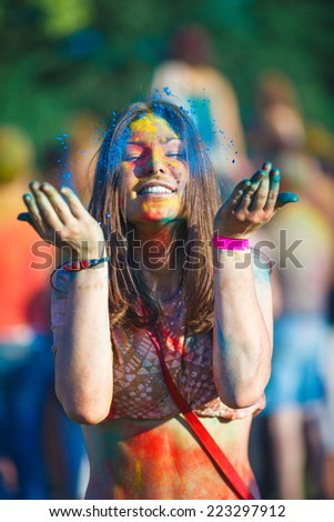 Happy woman face close-up. India holi festival.  - stock photo