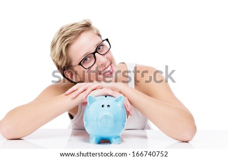 happy woman folding her arms over a piggy bank on white background - stock photo