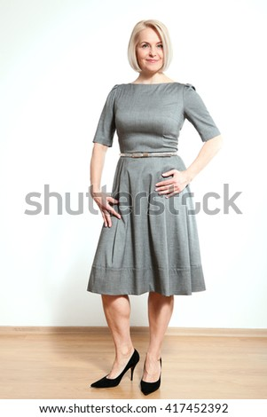 Happy woman full-length on white background. - stock photo