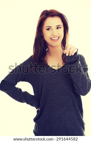 Happy woman getting an idea - stock photo