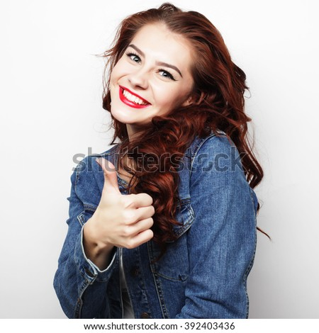 Happy woman giving thumb up - stock photo