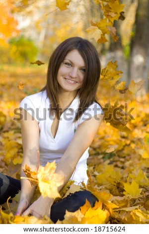 happy woman have relax in autumn park - stock photo