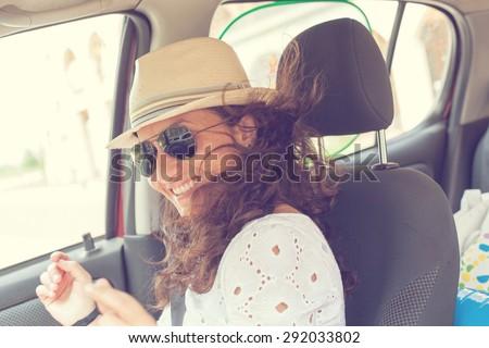 happy woman having fun in the car. Dancing - stock photo