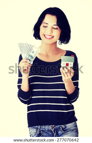 Happy woman holding a house model and dollar bills. - stock photo