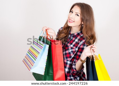 happy woman holding a shopping bag