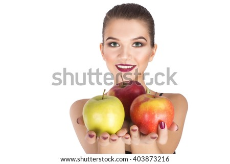 Happy woman holding apples diet concept