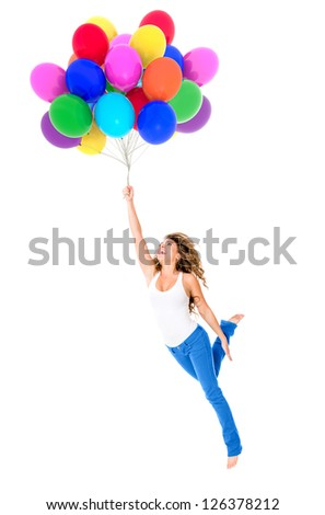 Happy woman holding balloons - isolated over a white background - stock photo
