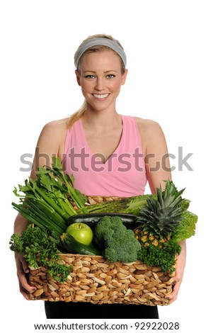 Happy Woman holding Basket of Green Fruits and Vegetables - stock photo