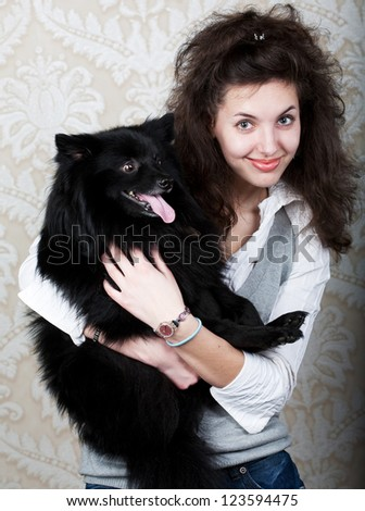 Happy woman holding black dog