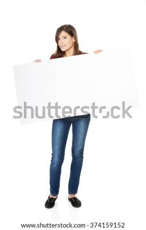 Happy woman holding empty banner. - stock photo