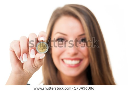 Happy woman holding euro coin on white background. - stock photo