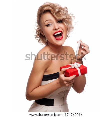 Happy Woman holding Gift Box.White background - stock photo