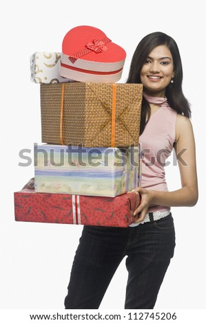 Happy woman holding gift boxes