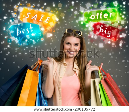 Happy woman holding shopping bags, concept - big sale - stock photo