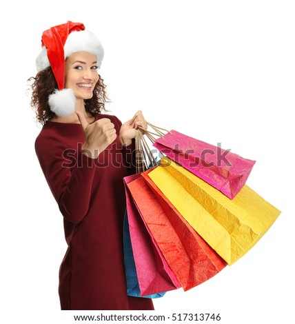 Happy woman holding shopping bags on white background. Christmas shopping concept