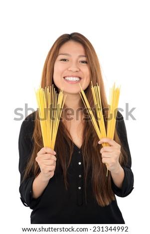 happy woman holding spaghetti pasta against a white background - stock photo