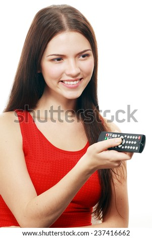 Happy woman holding TV remote control, over white background  - stock photo