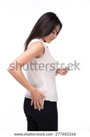 Happy woman holding US dollar bills over white background