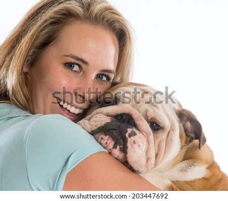 happy woman hugging her dog - english bulldog