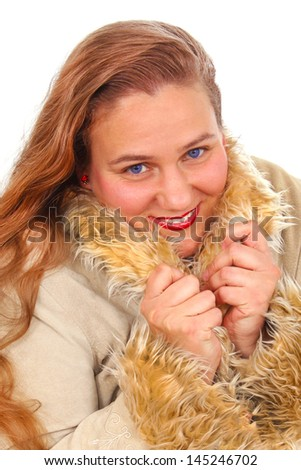 Happy woman in a coat with fur - stock photo