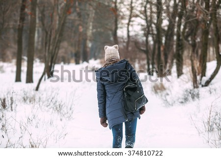 Happy woman in a winter forest.  - stock photo
