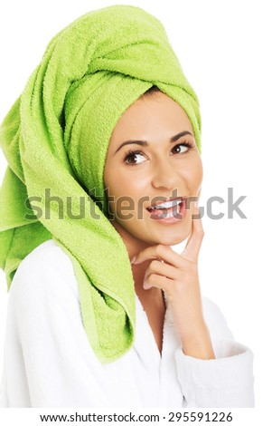 Happy woman in bathrobe and towel on head. - stock photo